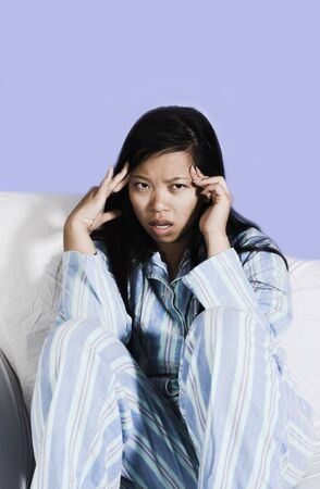 woman with headache over blue background Stock Photo - 532398