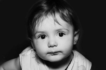 baby portrait over black background