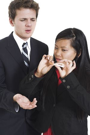 breaking: woman breaking cigarette in half beside collegue