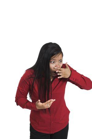 detestable: woman sensing bad smell over white background Stock Photo