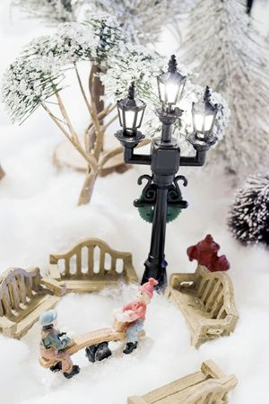 christmas scene in miniature kids playing Stock Photo