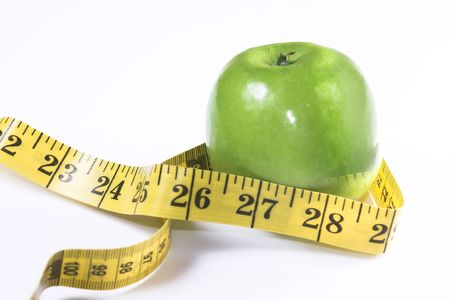 apple and measuring tape 스톡 콘텐츠