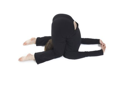 woman doing yoga pose over white BG photo