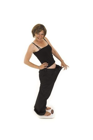 woman loosing weight Stock Photo