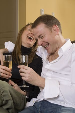 couple sitting on black couch drinking champagne Stock Photo - 743640