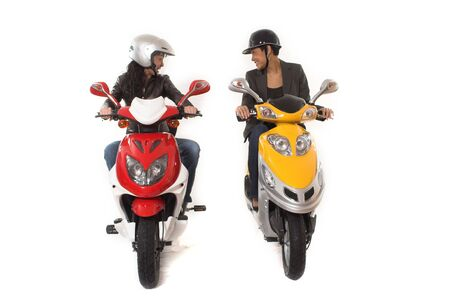 couple girls talking on  scooter over white background