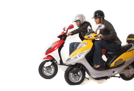 couple girls racing on electric scooter over white background Stock fotó