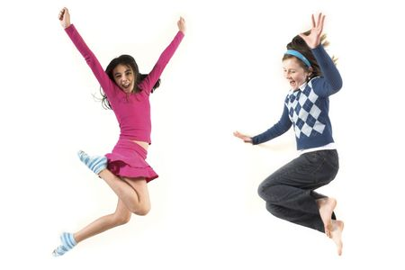joung girls jumping together over white background