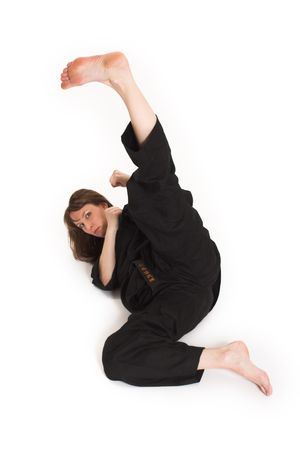 woman doing karate over white background Banco de Imagens