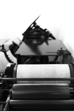 ancient printing machine in print shop photo