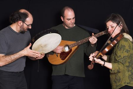 trio: band playing celtic music over black background Stock Photo