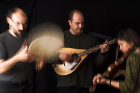 band playing celtic music over black background - blur effect