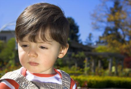 Little boy portrait over trees and blue sky - use of reflector