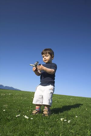 child standing in field over deep blue sky