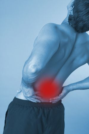 backpain: close up of a young man back over blue background Stock Photo