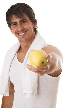 young man standing: Ritratto di giovane uomo in piedi e in possesso di un mela su sfondo bianco