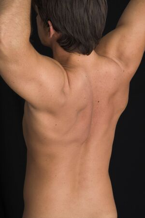 close up of a young man back over black background