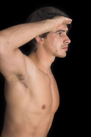 portrait of young man standing with no shirt on over black background Imagens - 1005171