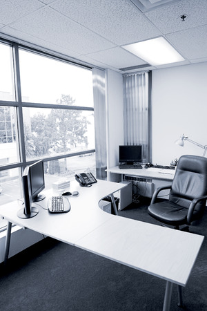 wide angle of office desk in blue tone Stock Photo