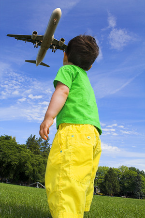 child playing with truck outside over deep blue sky