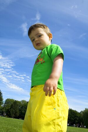 child standing outside over deep blue sky Stock Photo - 1379811