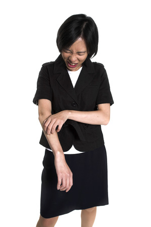 young woman scratching her arm over white background