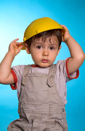 portrait with construction hat over blue background