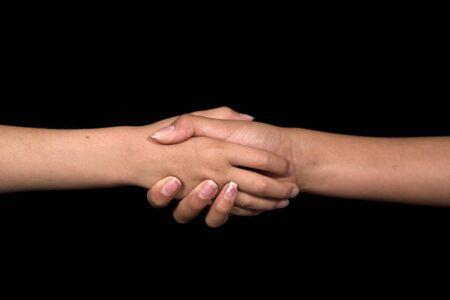 niños haciendo señales con las manos sobre fondo negro Foto de archivo - 1575537