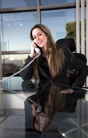 business woman indoor shot sitting at her desk