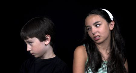 brother and sister arguing over black background photo