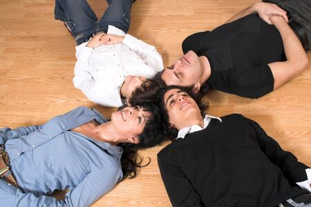 happy family spending time together on hard wood floor photo