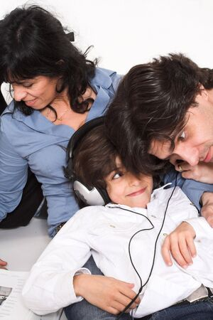 happy family spending time together with teen listening to music photo
