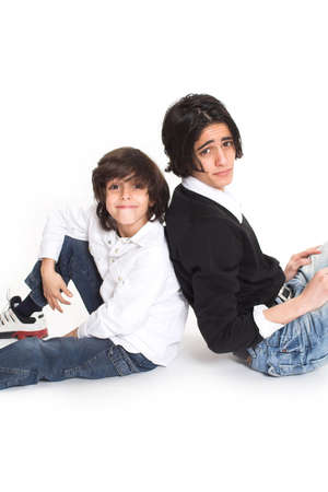 brothers spending time and posing together over white background