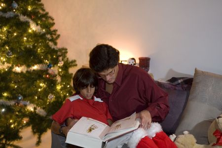 father and son on couch at christmas Stock Photo - 2021200