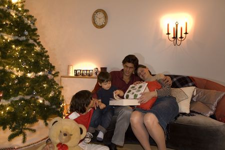 happy family having fun and opening gift at christmas time Stock Photo - 2021201