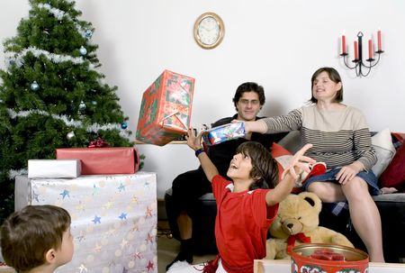 happy family having fun and opening gift at christmas time