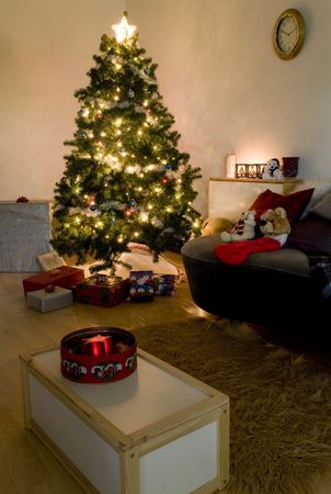 christmas tree at night time with candles and light setup