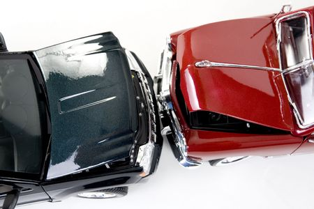 liability insurance: close up of collectible car over white background