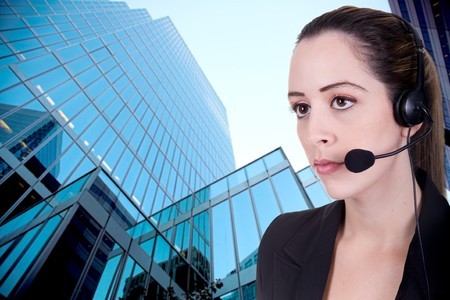 business woman on the phone over business building