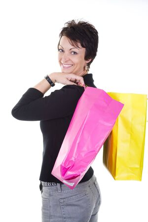 woman with shopping bags over white background photo
