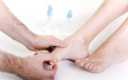 fem: foot care shot with woman feet over white background Stock Photo