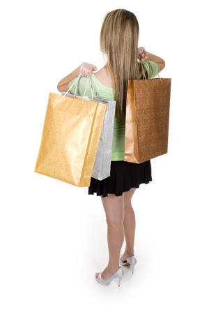 overwhite: woman with shopping bags over white background