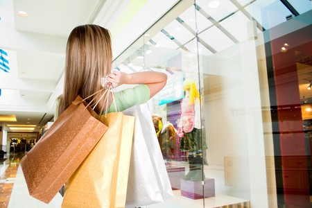 woman standing in mall with shopping bags photo