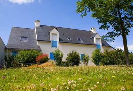 house in brittany with flowers and grass over blue sky Stock Photo - 4359222