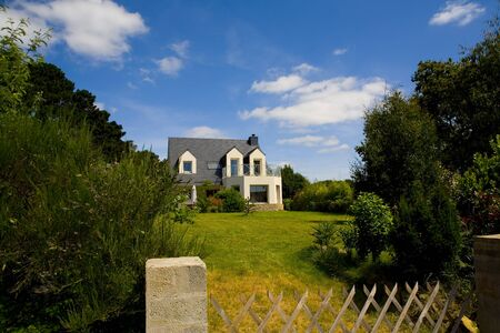 house in brittany with flowers and grass over blue sky Stock Photo - 4359234