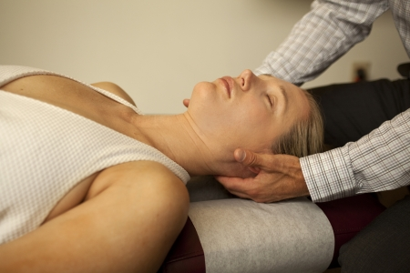 chiropractor with patient at a chiropractic clinic Stock Photo