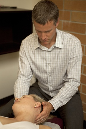 chiropractor with patient at a chiropractic clinic Stock Photo - 10374597