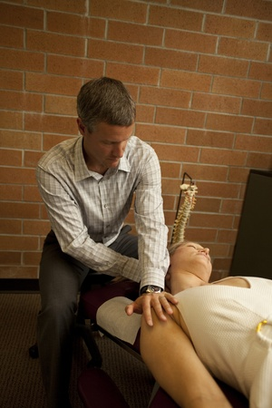 chiropractor with patient at a chiropractic clinic photo