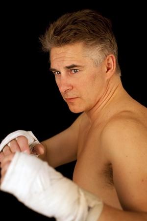 man boxing posing over black background Stock Photo - 10375037