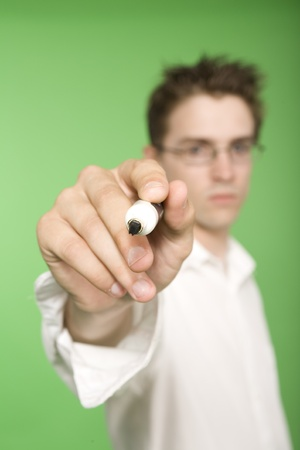緑色の画面上をペンで書く男 写真素材